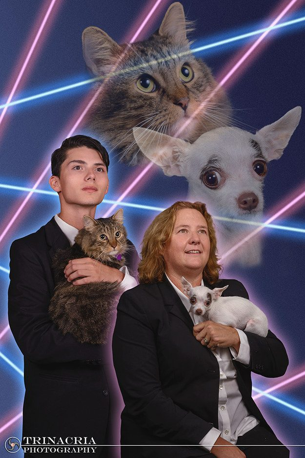 Schenectady High School senior Draven Rodriguez and Principal Diane Wilkinson pose with their pets in a quasi re-creation of Rodriguez' proposed senior portrait that went viral earlier this month. This compromise photo will get in the yearbook.