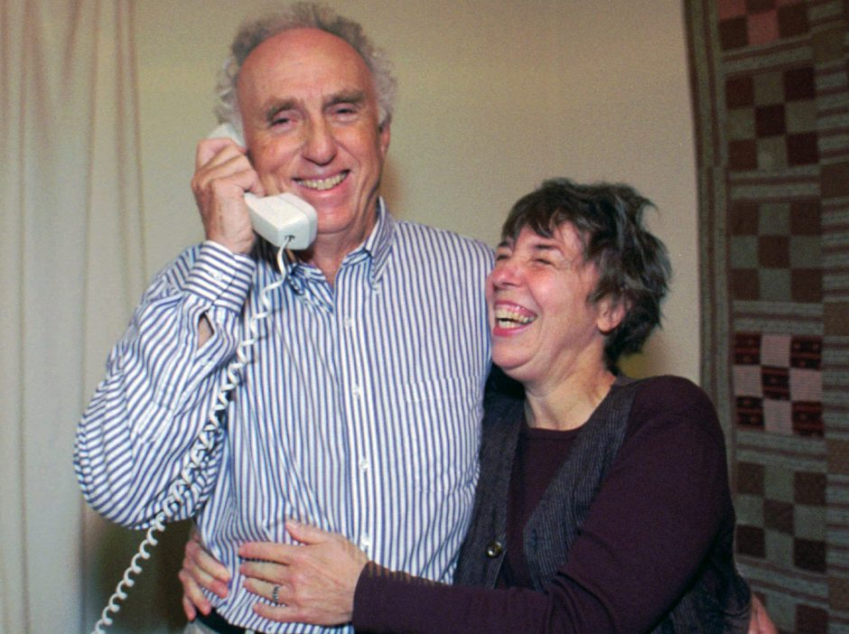 In this Oct. 11, 1995 photo, Stanford University's Martin Perl gets a hug from his wife, Judy, after hearing that he won the Nobel Prize in physics, as he is congratulated by his son by telephone at his home in San Francisco.