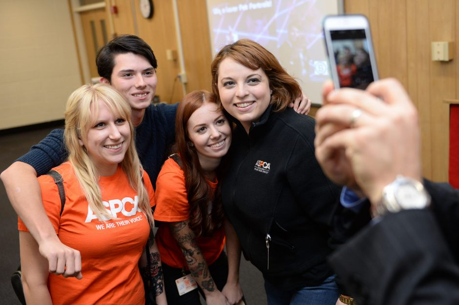 Schenectady High School senior Draven Rodriguez, center, poses for a picture with American Society for the Prevention of Cruelty to Animals (ASPCA) representatives Alison Jimenez, right, Carly O'Malley, center, and Kelly Newner, left, following a press...