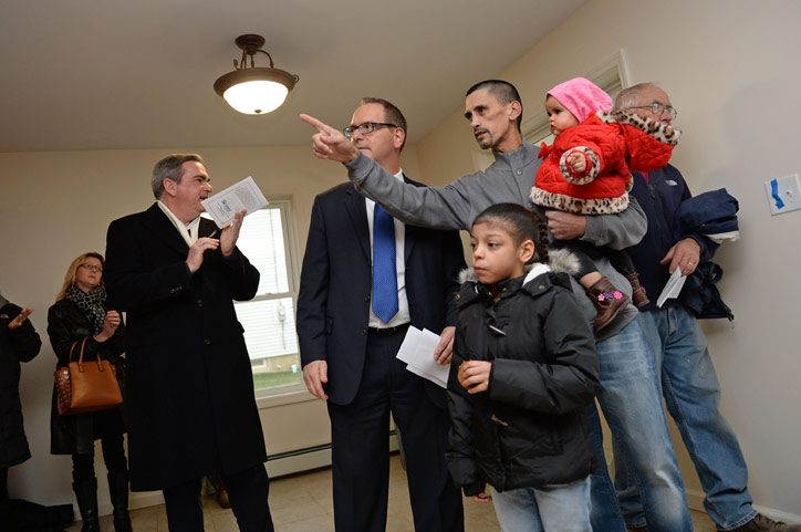 Jose Gonzalez and his daughters Kayshalee, 8, and Nayshaalee, 9 months, look at their new Habitat for Humanity home on Van Vranken Avenue in Schenectady on November 22, 2014 with Habitat for Humanity of Schenectady County Executive Director John Scharf...