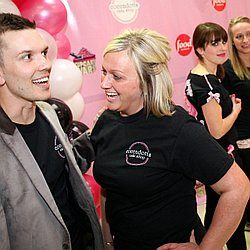 Owner Rachel Dott, right, and Jake Allen, left, morning show host on 104.9 The Cat and host for the evening for a live broadcast of Food Network's Cupcake Wars episode with Coccadotts Cake Shop in Clifton Park Center Mall Food Court on Sunday, April 28...