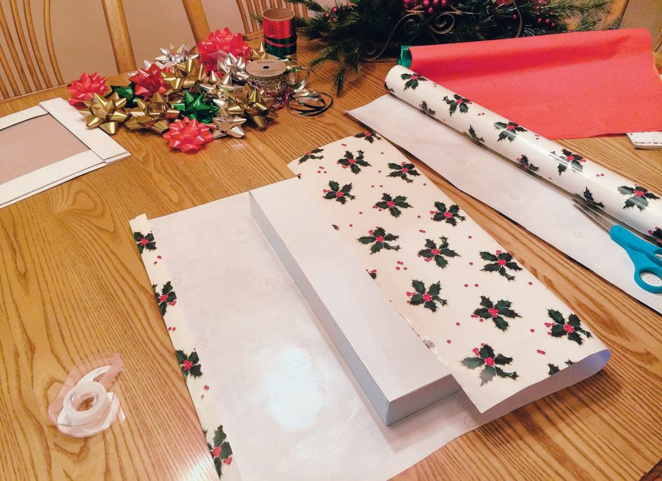 After taping down one side of the wrap, make a fold along the other for a clean edge. (Pat Clark/Modesto Bee)