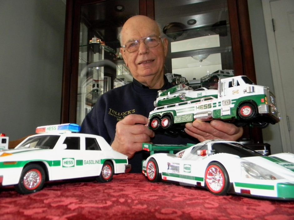 Dick Tullock of Rexford holds a Hess toy rig above the Hess police and race cars. Tullock has about 25 Hess models in his collection. (Jeff wilkin/Gazette reporter)