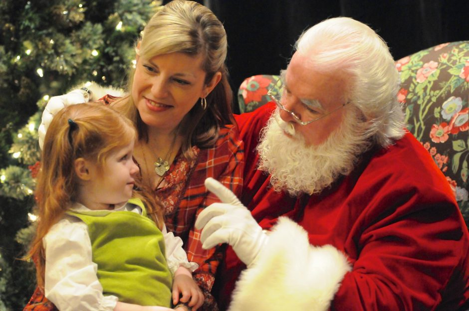Lara Preble of Saratoga with daughter Shaylen, 3, talk to Santa at the 20th Annual Breakfast with Santa on Christmas Eve day. The breakfast this year benefits The Saratoga Warhorse nonprofit.