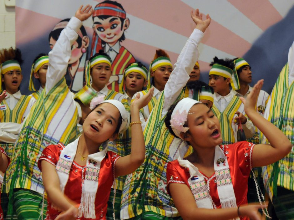 A Burmese youth troupe from Utica performs a Don Dance during Karen New Year 2015 celebration at the Albany Boys and Girls Club on Delaware Ave. in Albany on Sunday.