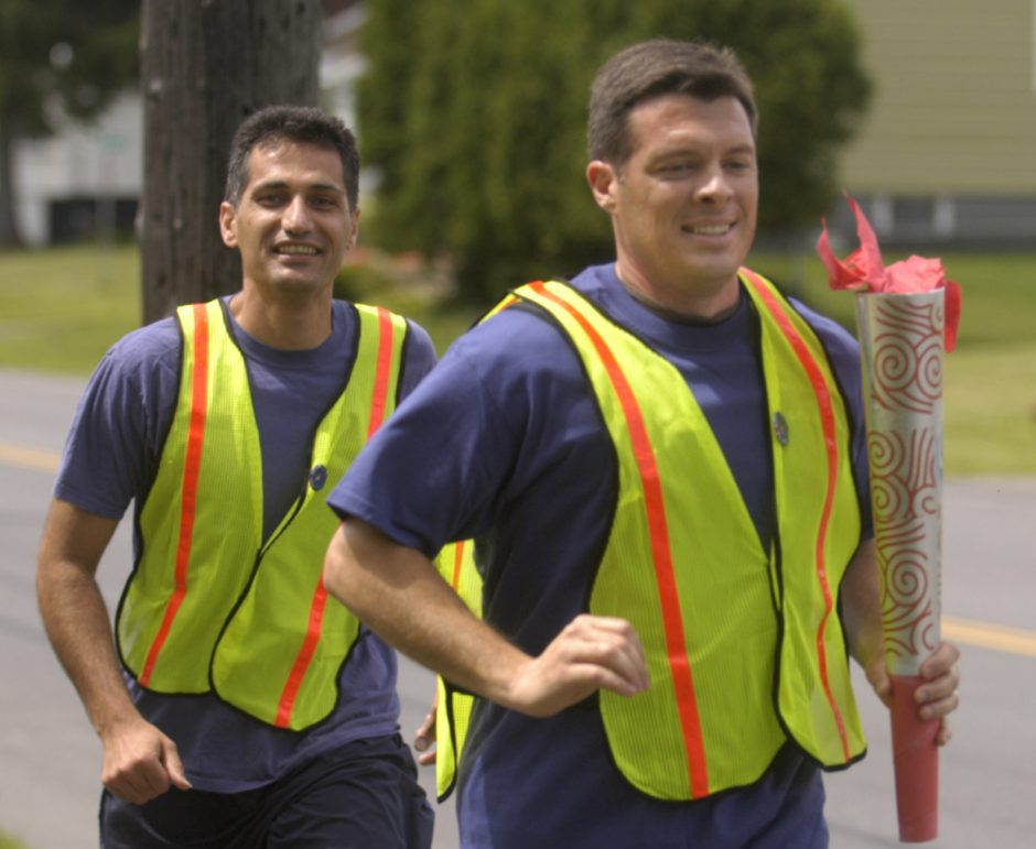GE employees Reza Sarrafi, left, and Paul DiConza jog along Rosa Road towards GE Global Research in Niskayuna during the GE Walk for Education on Friday. The walk was to benefit Northeast Parent and Child Society.