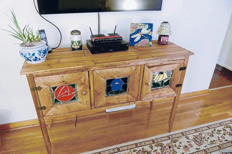 Using old wooden pallets, Dr. Alex Yergiyev made this chest. (Bill Wade/Pittsburgh Post-Gazette)