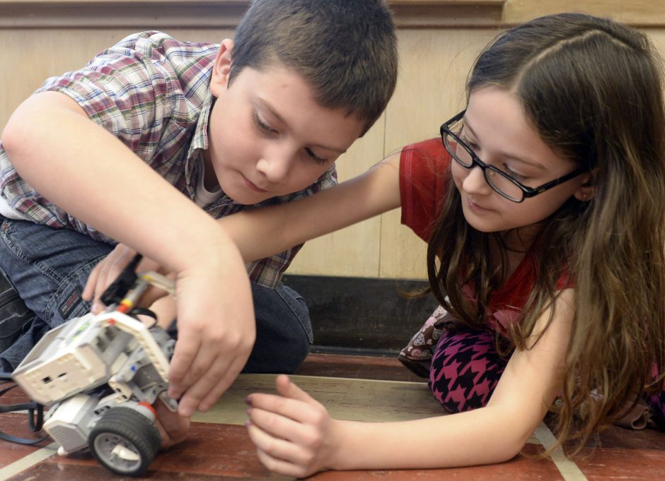 Duanesburg Elementary School 4th graders Austin O'Bryan, 9, left, and Isabelle Acevedo, 9, work on their Lego Robotics project in Geoff Switts class Wednesday, February 4, 2015.