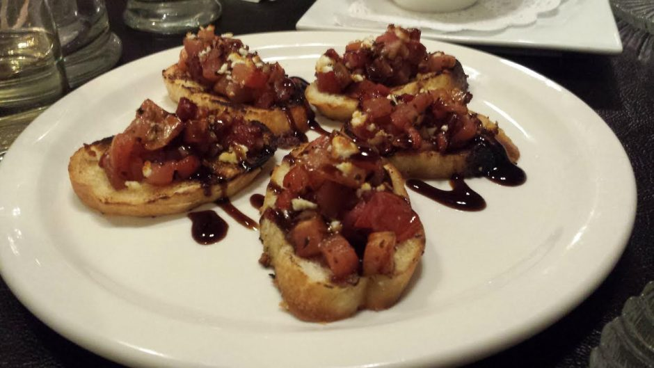 Spindle's bruschetta is piled with fresh chopped tomato, garlic and feta, drizzled with sweet, dark balsamic vinegar, all over toasted French bread.