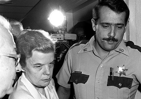 Marybeth Tinning is escorted from Schenectady County Court during her trial by Gordon Pollard.