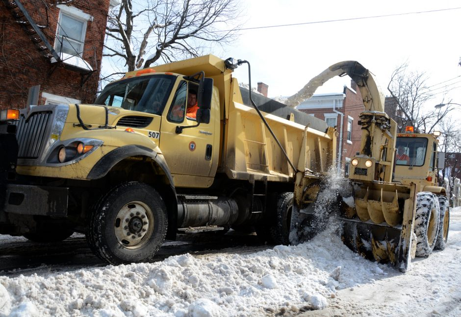 Schenectady DPW crews remove snow from the banks along Washington Ave. at Union St. on Wednesday afternoon.