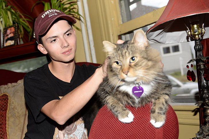 Draven Rodriguez and his cat Mr. Bigglesworth at their home in Schenectady on September 10, 2014.