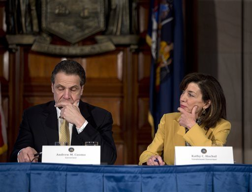 New York Gov. Andrew Cuomo, left, and Lt. Gov. Kathy Hochul listen to a speaker during a cabinet meeting in the Red Room at the Capitol on Wednesday, Feb. 25, 2015, in Albany, N.Y.
