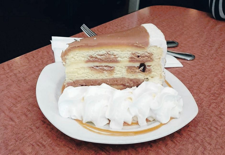 Peaches Cafe serves a caramel layer cake with homemade vanilla cake layers, toffee filling, real buttercream frosting, a creamy cheesecake-type layer and caramel sea salt topping. (Caroline Lee)