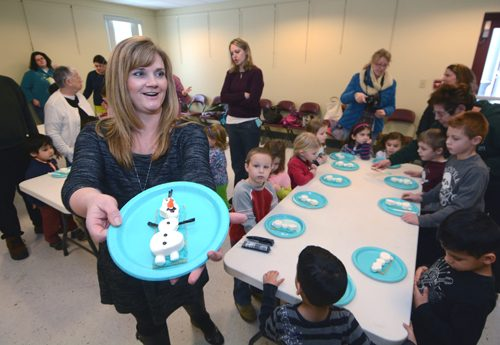 """Lead instructor Jodie Fitz shows off a finished """"Olaf"""" marshmallow treat at an activity for kids at the Town of Ballston Library in Burnt Hills. The kids were having a """"Frozen"""" party, based on the animated film."""
