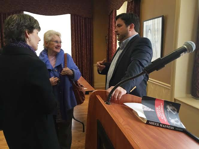 """Schenectady native and former federal prosecutor Andrew McKenna, right, talks after a lecture Wednesday at Schenectady County Community College on his memoir """"Sheer Madness."""" (Steven Cook)"""