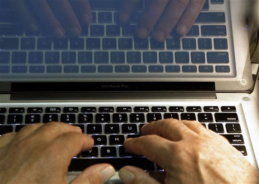 In this Feb. 27, 2013 photo illustration, hands type on a computer keyboard in Los Angeles. Tech experts agree that traditional passwords are annoying, outmoded and too easily hacked.