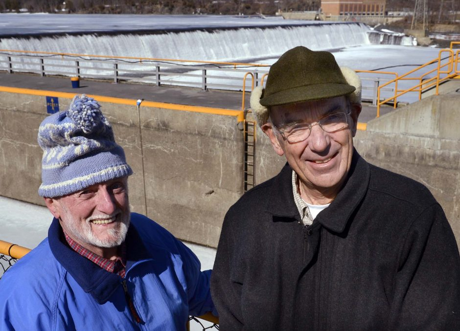 Jim Duggan, left, and Russ Wege stand at Lock 7 in Niskayuna with the dam in the background on Thursday.
