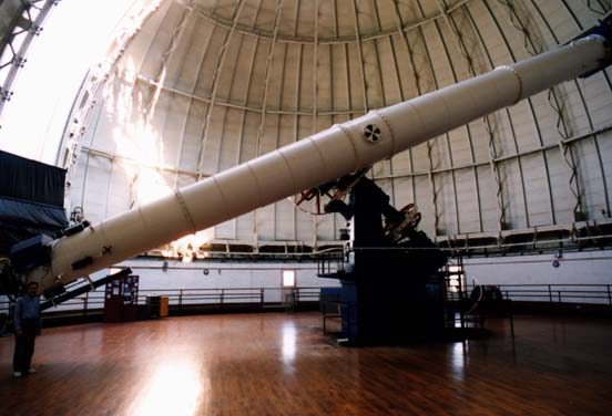 University of Chicago Professor Kyle Cudworth stands in the  by the Yerkes Observatory telescope, a 40-inch refractor.