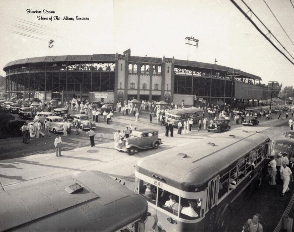Buses and cars are parked and people are starting to file into Albany's Hawkins Stadium to watch the Albany Senators play baseball around 1950. ( miSci, General Electric Archives)