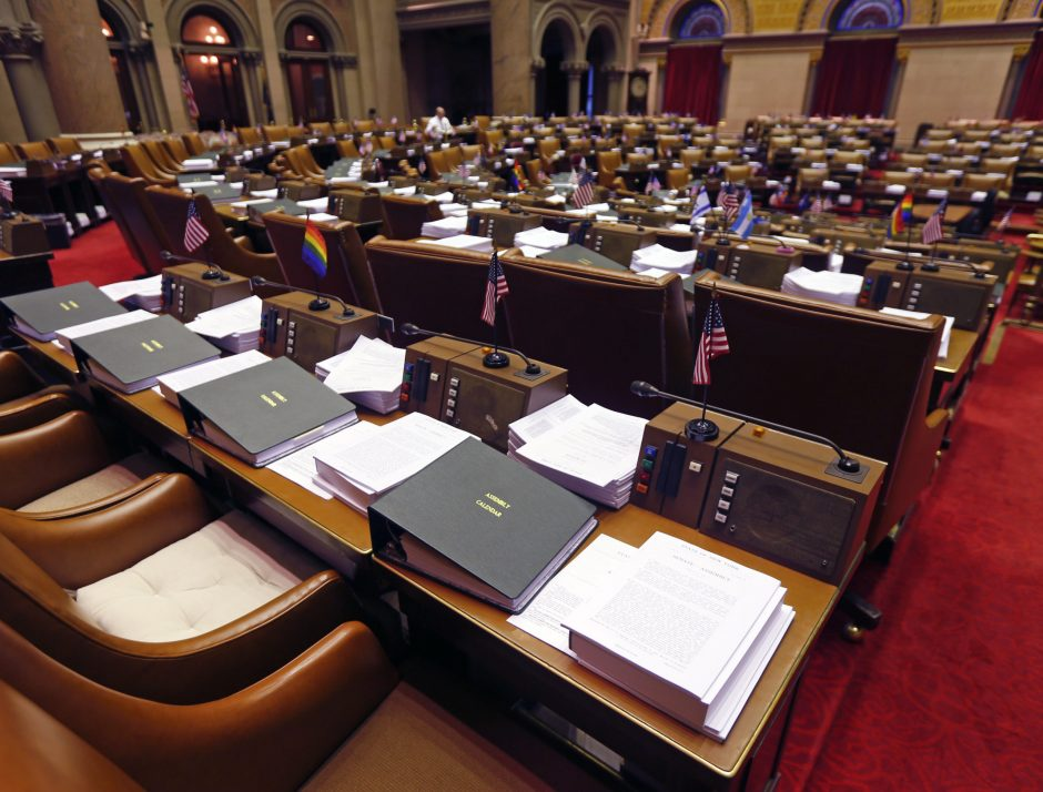 Budget bills sit on legislators' desks in the Assembly Chamber at the state Capitol on Monday.