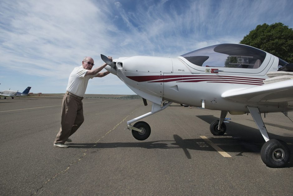 Peter Weber Jr. pushes back his plane after his flight on March 30, 2015, in Placerville, Calif. His bid to establish the Guinness World Record as the oldest living active pilot went flawlessly, taking to the skies over Placerville on a sunny morning. ...