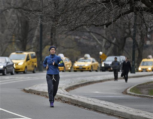 A person takes a morning run through Central Park in New York, Thursday, April 9, 2015. Many business travelers like to go out for morning jogs in whatever city they're traveling to.
