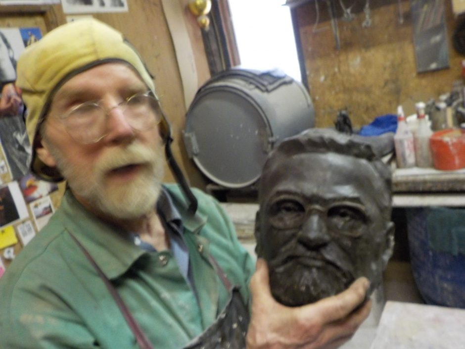 Sculptor Dexter Benedict holds a wax head of Charles Steinmetz, which will be cast in bronze over the next few weeks.