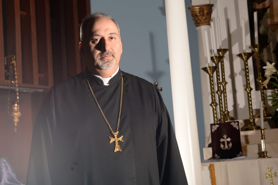 Father Stephanos Doudoukjian poses for a picture at St. Peter's Armenian Church in Watervliet on Thursday, April 16, 2015.