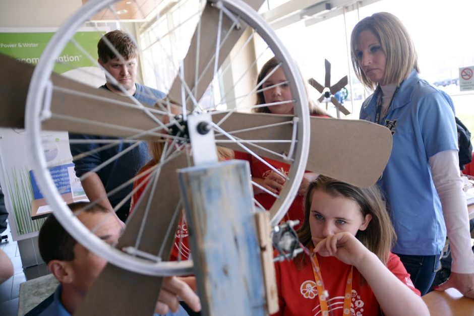 Students and teachers from Gregory B. Jarvis Middle School in the Herkimer County village of Mohawk discuss possible improvements to their wind turbine Saturday morning during the KidWind Challenge at GE's Renewable Energy headquarters in Schenectady.