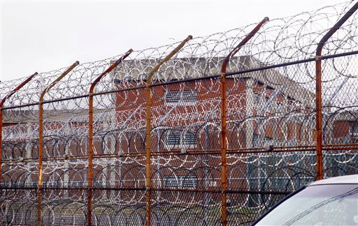 In this March 16, 2011 photo, a security fence surrounds the inmate housing on New York's Rikers Island correctional facility in New York. More than 200 advocates and several legislators are calling for restricting solitary confinement for state inmate...
