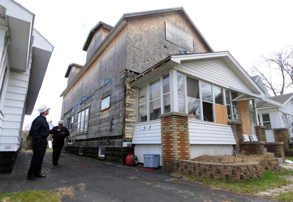 """Schenectady City Fire Chief Raymond Senecal and Assistant Fire Chief Michael Gillespie look over a  """"Zombie"""" property located at 1575 Santa Fe St. on Monday April 27, 2015."""