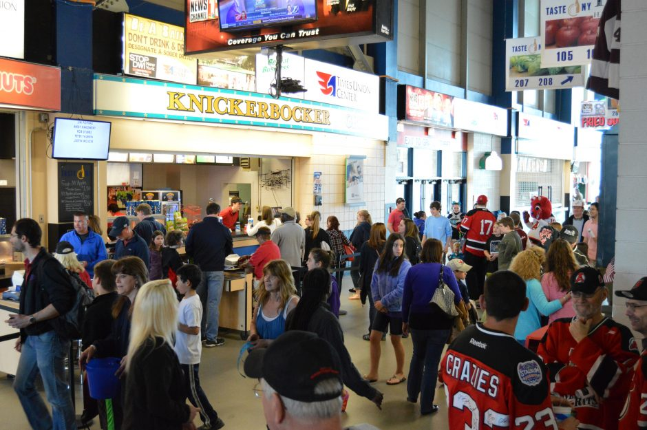 Hockey fans crowd the concourse level of the Times Union Center prior to an Albany Devils game against the Hartford Wolf Pack easlier this month.