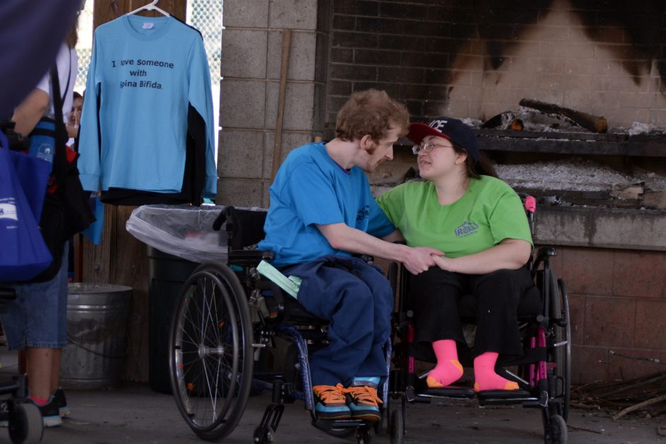 Greg Chamberlain of Glenville and Bryanna Lyman of Greenville hang out at the 5th annual Walk-n-Roll for Spina Bifida on Saturday, May 2, 2015, in Schenectady's Central Park.