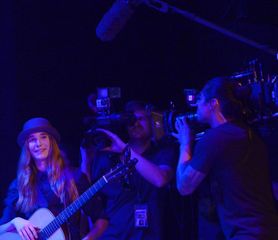 Sawyer Fredericks is surrounded by video cameras recording his performance Wednesday night at the Palace Theatre in Albany.