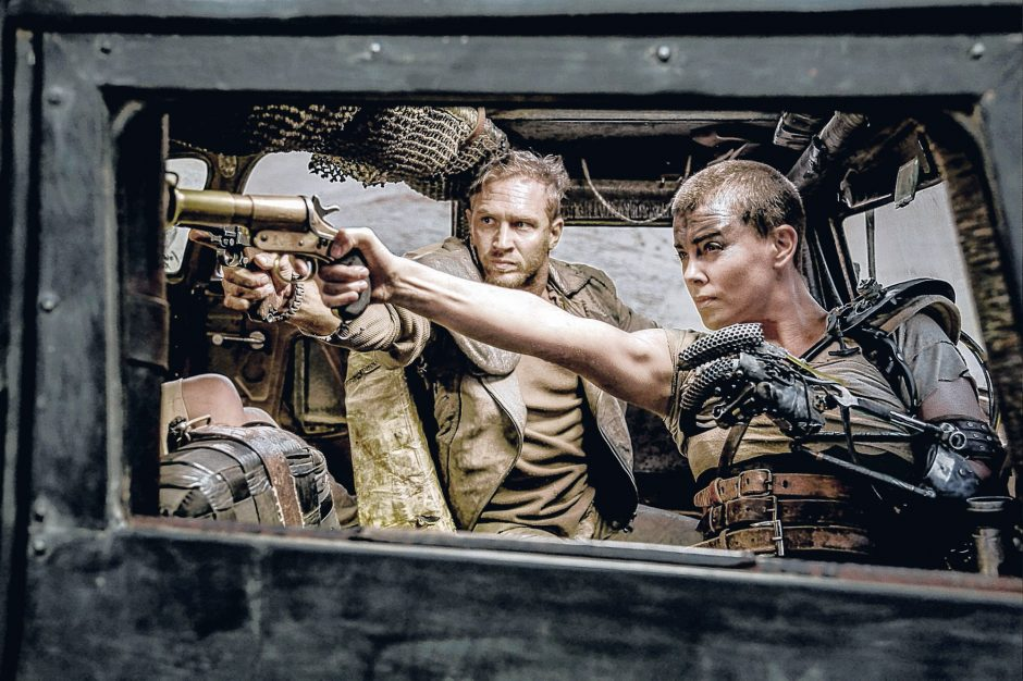 Tom Hardy as Max Rockatansky and Charlize Theron as Imperator Furiosa in the action adventure film 'Mad Max: Fury Road.'