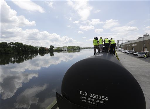 Firefighters and other first responders are familiarized with tank cars on the CSX Safety Train next to the Hudson River in the Port of Albany on Thursday, June 5, 2014, in Albany, N.Y.