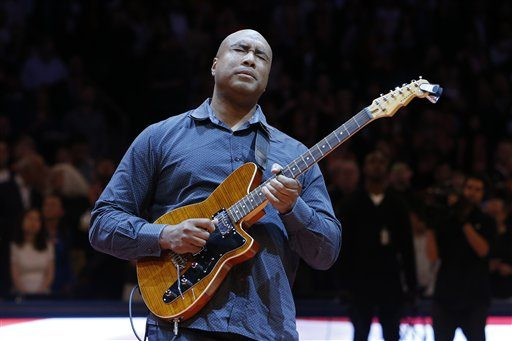 Former New York Yankee baseball player Bernie Williams plays the nation anthem on a guitar before an NBA basketball game between the Miami Heat and the New York Knicks Saturday, Feb. 1, 2014, in New York. Miami won 106-91. (AP Photo/Jason DeCrow)