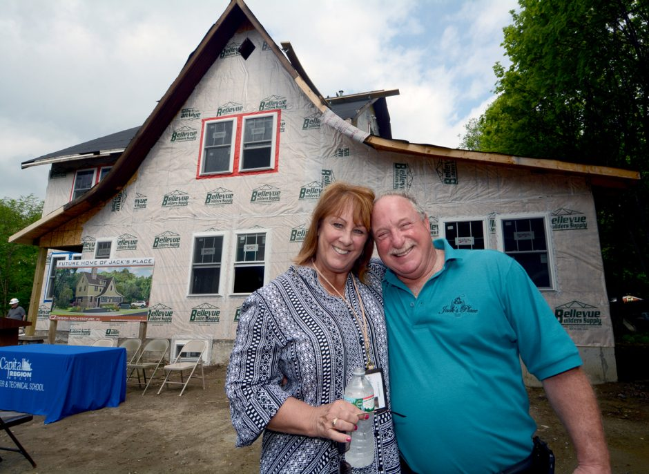 Kate and Jack Falvo Jr. pose in front of Jack's Place, which is being built at 17 Rosa Road in Schenectady, on May 27, 2015.