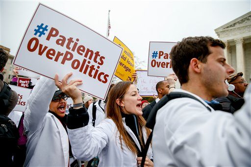 In this March 4, 2015 photo, demonstrators chant during health care rally outside the Supreme Court in Washington.