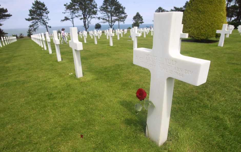 A red rose sits on the grave in Colleville sur Mer, France, of Louis J. Kulp, an American serviceman who died June 12, 1944, during the Allied assault on Normandy.