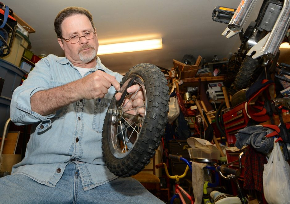 Clifton Park resident Philip Miranda works in the cellar of his home and repairs bicycles as a hobby. He then sells the bikes for $10.