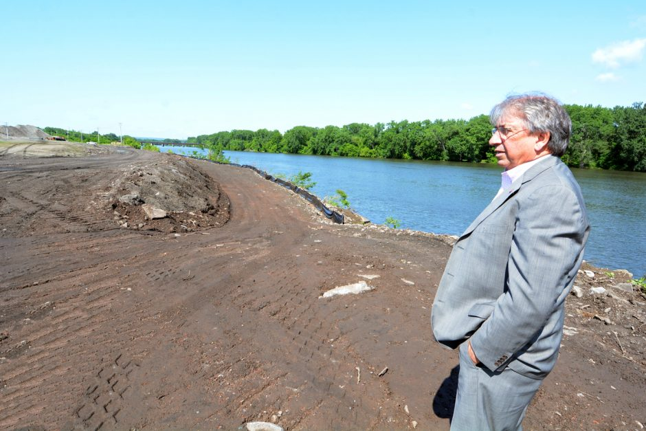 David M. Buicko, chief operating officer of the Galesi Group, shows the walkway next to the Mohawk River that is under construction for the Rivers Casino & Resort at Mohawk Harbor on Wednesday.