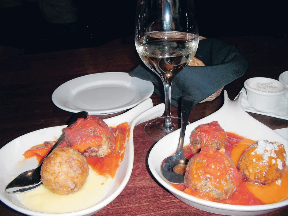 Meatballs make the meal at Three Vines Bistsro. Shown are lobster and veal on the plate at left, and veggie, sausage and chicken on the right. (Karen Bjornland/Gazette reporter)