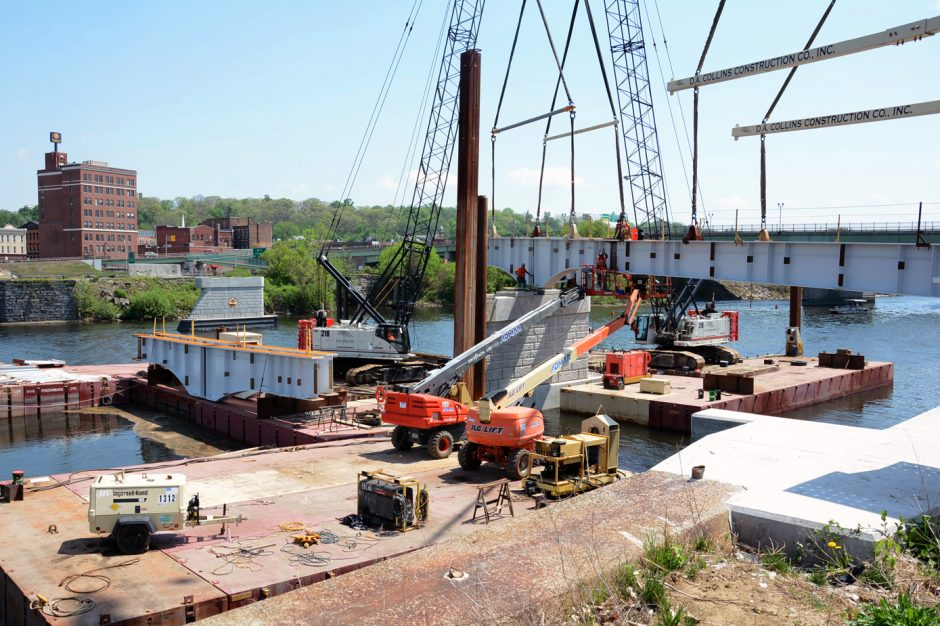 D.A. Collins Company installs the first steel girder span for the new pedestrian bridge being built over the Mohawk River  in Amsterdam in this May 11, 2015, file photo.