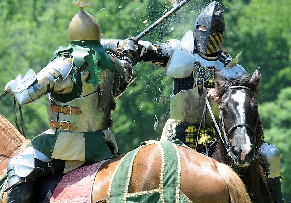 """Olrich of Slavia, left, jousts """"Angus"""" during the  NY Capital District Renaissance Festival parade held at Indian Ladder Farms in Altamont on Sunday June 14,2015."""