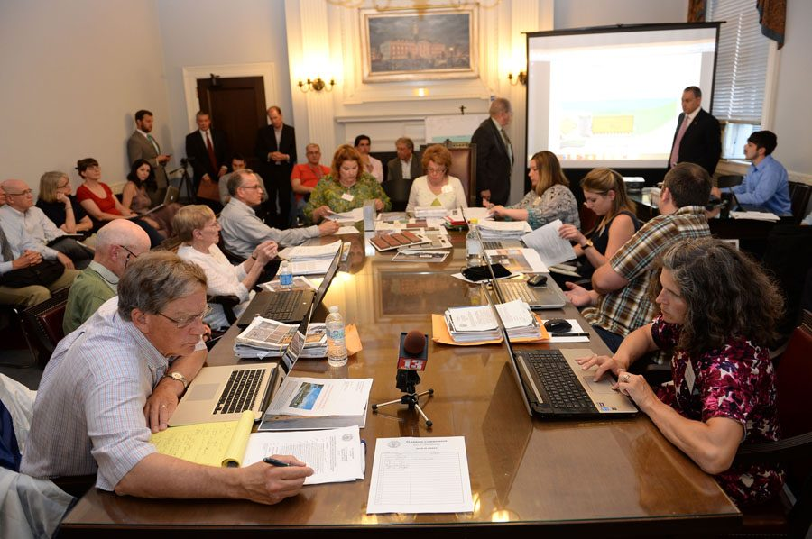 Members of the Schenectady Planning Commission consider the new design for the planned Rivers Casino and Resort during a public meeting at Schenectady City Hall on Wednesday, June 17, 2015.