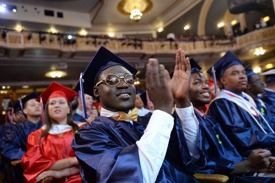 Kwazie Farrell, front, cheers during the Schenectady High School commencement at Proctors on Friday, June 26, 2015.