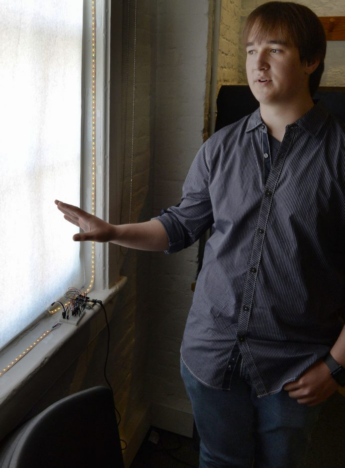 RPI student Zachary Pearson helped design the control panel for each window to be illuminated.