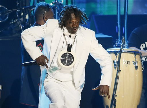 Flavor Flav of Public Enemy performs during the band's induction at the Rock and Roll Hall of Fame Induction Ceremony at the Nokia Theatre in Los Angeles, April 18, 2013.
